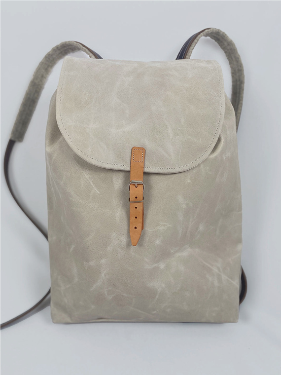 eco leather backpack made in amsterdam snekkerbuks off white pack shot front
